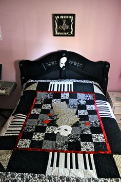Phantom of The Opera Quilt.   My Mom made this and my Gma helped sew it all together! I can't sew so I helped with the design/picking fabric part of it. I love the Phantom of The Opera broadway musical & all things Phantom. This completes my room! :) There is no pattern to this quilt unfortunately, it was more of a creative effort and a quilt inspired by one we saw online.