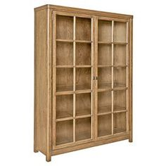 Cabinet-style bookcase in woodstone with two doors.   Product: BookcaseConstruction Material: Oak solids, wood veneers and glassColor: WoodstoneFeatures: Two cabinet doors with interior shelvingDimensions: 73 H x 54 W x 20.75 D