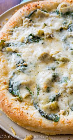 If you like spinach artichoke dip, this garlic white cheese pizza is for you!