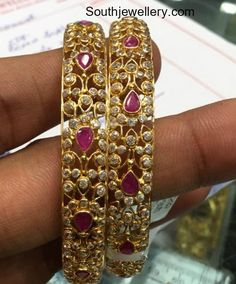 22 Carat gold bangles studded with rubies and cz stones by Premraj Shantilal jewellers. stones bangle models, gold bangles, cz bangles, ruby bangle models