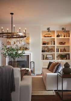 The large Hinkley Wells chandelier adds a big dose of chic, industrial-inspired style to this relaxing living room. Vintage Chandelier, Vintage Lighting, Chandelier Lighting, Cozy Living Rooms, Living Room Decor, Living Spaces, Family Room Lighting, Living Room Lighting, Condo Design