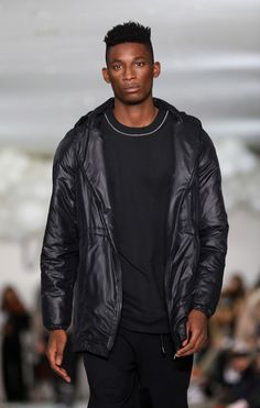 Harry Uzoka walks the runway at the What We Wear show during London Fashion Week Men's January 2017 collections at BFC Show Space on January 7, 2017 in London, England.