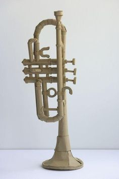 cardboard music instrument-this would go well with the Oldenburg giant cardboard shoe project. Cardboard Sculpture, Cardboard Paper, Cardboard Crafts, Paper Sculptures, Sculpture Lessons, Sculpture Projects, Sculpture Art, School Art Projects, High School Art