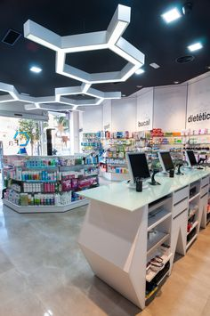 LOW FIXTURES;www.concep.es Diseño de Farmacias. Pharmacy design . Drug store design.