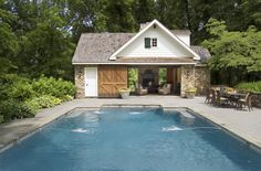 Pool house modeled after a 9th-century colonial farmhouse- look at the  built in fireplace!