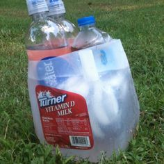 Milk jug water bottle cooler. Cut the top off, fill with ice water, and now you have a cooler that will hold at least 3 water bottles! #diy #MilkJugs