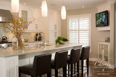 classic white kitchen with large island and shaker style door