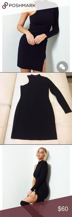 """Donna Mizani one sleeve mock neck dress Donna Mizani one sleeve mock neck dress. 90% nylon 10% spandex. Dry clean only. Worn once. Like new condition. 33"""" top to bottom donna mizani Dresses One Shoulder"""