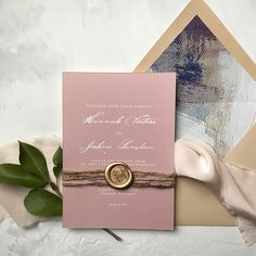 Created by Papertreee Studio. A lovely invitation in dusty rose with modern calligraphy paired with a gold wax seal!