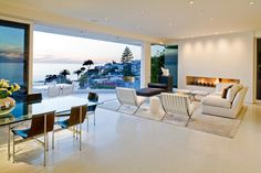 Magni Design - Laguna Beach   Pacific Overture - Stone spheres line up to create a sleek, geometric fireplace Overture, Outdoor Furniture Sets, Outdoor Decor, Laguna Beach, Architecture Design, Dining Table, Minimalist, House Design, Living Rooms