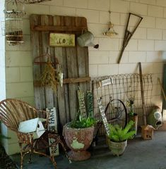 old barn door used for outside decoration, hanging watering can, very rustic.