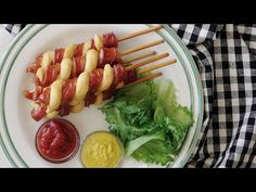 Hot dog spiral twists. Here's the recipe: What you'll need - Hot dog - Skewer - Puff Pastry - Skewer a hot dog the long way. Cut a spiral by holding your knife at a diagonal to the...