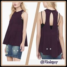 Ribbed Mock Neck Tank Short mock turtle neck.  Trapeze shape.  Key hole back.  All-over semi sheer ribbed burnout knit.  Polyester/Rayon.  Sleeveless, cut-in armholes. From Express One Eleven Collection. Color:  Currant. Express Tops Tank Tops