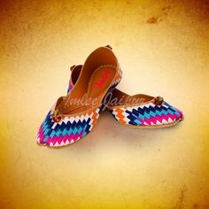 A graphic multicoloured zigzag design with pintucks mojaris for that spunky chic look..goes well with westerns or indian wear.