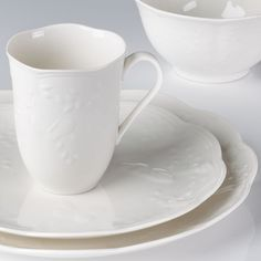 Butterfly Meadow Cloud, with embossed butterflies and vines on pure white dinnerware, is a new look for a classic Lenox pattern.