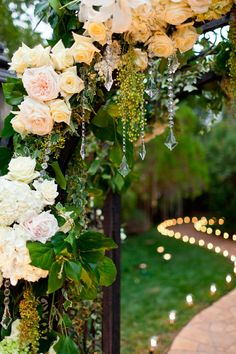 So sweet: touch of dripping crystal, greenery, white flowers (background candlelight path)