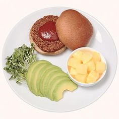 Baja Burger 1 vegetarian burger 1 whole wheat bun 1 tablespoon BBQ sauce 1/4 avocado, thinly sliced 1/4 cup bean sprouts 4-ounce pineapple cup, in its own juice Make it: Cook burger in microwave according to package directions. Place on bun with BBQ sauce; top with avocado and sprouts. Eat with pineapple.