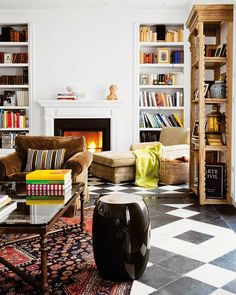 THOSE FLOORS ARE EVERYTHING!!!! bookshelves, black stool, x-bar coffee table, brown velvet chair