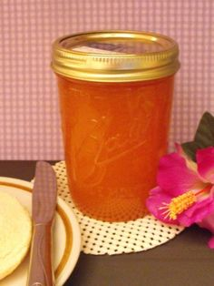 Home Canned Peach Jam  4 cups - finely chopped peaches (pitted and pealed)   2 tbsp - lemon juice   1 - package (1.75 oz) of regular powdered fruit pectin   5 cups - granulated sugar