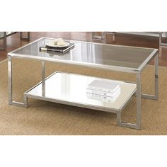 Contemporary and elegant, the Cordele chrome and glass coffee table is the perfect accent to enhance your living space. The shiny chrome frame with smoked glass top and raised base will make a statement in your home.