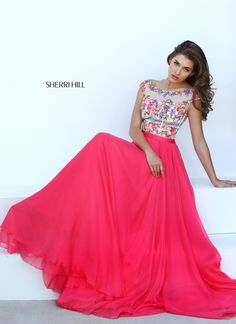 5b9266ece67 Draw attention to your hidden beauty in Sherri Hill Boat neckline with cap  sleeves feature this ethereal creation. This dress is styled with multi  print ...