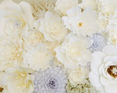 Want that gorgeous paper flower Chanel backdrop we all swooned over on the runway?  I make custom 3D paper flowers out of heavy weight cardstock in your color choice so you can enjoy a high fashion look too! Perfect for a wedding backdrop, bridal shower, baby shower, nursery--the possibilities are endless! This listing is for one (1) 18-20 inch diameter giant flower in white in the flower form pictured. Please contact me for customization in color, size, shape.  Please note that due to the…