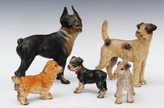 "Group of Five Cast Iron Dog Door Stops  	Sold For $ 425      	                  largest is 10"" high   Condition report  all with original paint and modest wear"