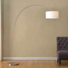 Upgrade your living room with this simple, sleek modern Adelina arched floor lamp from Artiva USA. With an adjustable shade to let you direct the light right where you need it, this lamp is perfect addition to any home or office.