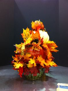 Pumpkin time!  Stack of pumpkins with fall leaves.  Laura A.  2014. Michaels, Tulsa
