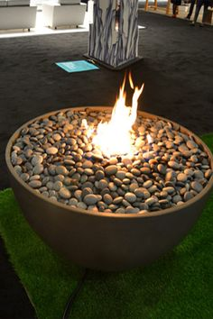 48 Fire Bowl, 120,000 BTUs output. Available inn natural gas or propane burned, lava rock bed