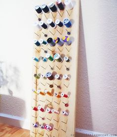 Construct a simple thread organizer with some nails and a board. | Community Post: 45 Organization Hacks To Transform Your Craft Room