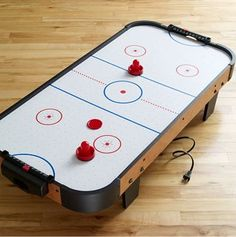 http://theshoppingmama.com/wp-content/uploads/2010/11/table-top-air-hockey-table.jpg