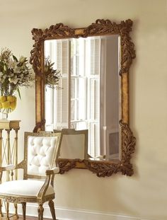 Hand carved rectangular mirror in burnished antique gold, Acanthus leaf motif. Beveled.