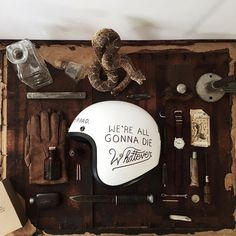 """""""Hand-illustrated motorcycle helmets is definitely happening. We took that old school sayin' from way back and actually applied it! Whiskey, rattlers and…"""""""