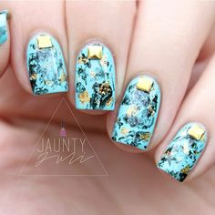 Turquoise Nails With Gold Studs.