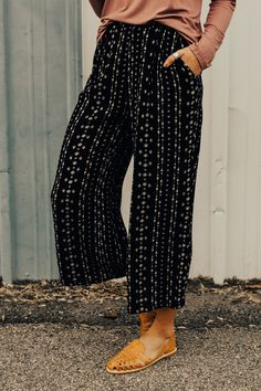 "Black Cropped Gauchos Arrow + Geometric Print Detail Wide Leg Pant Elastic Waist Side Pockets View Size Chart Model is 5'9"" + Wearing a Small"
