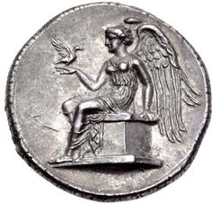 Silver Nomos from Terina, Bruttium, C. 400-356 BCThis ornate coin shows Terina the water nymph with TEPINAIΩN inscribed to the right. The reverse shows Nike seated  on a plinth, holding out her hand upon which sits a small bird.The ancient city of Terina  (map) was located in Bruttium, Magna Graecia (Italy).[[MORE]]In the fifth century BC the Greek cities Croton and Locri, both located on the Ionian Sea, vied for the control of ports on the Tyrrhenian Sea. These ports were important for…