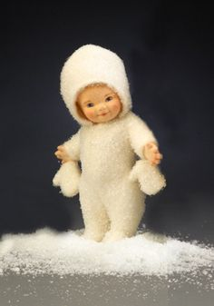 "RJW - Snowbaby 6"" all-felt; fully jointed; hand painted features. Dressed in sparkle-encrusted wool plush snowsuit with matching cap and mittens. Date of Release: 2006 Ltd. Ed. 100. First piece in the SNOWBABY COLLECTION. Made exclusively for the ""Christmas in July"" R. John Wright special ticketed event at the annual IDEX show."