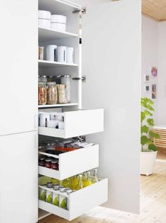 This is what I want near the fridge for rice milk, wine, and soft drink in waiting. White cupboard detail from the Metod Kitchen by Ikea