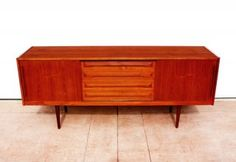 """Mid-Century Danish Teak Credenza/Sideboard  Gorgeous Danish Sideboard/Credenza in Teak circa late 1950's.  Features 4 central drawers & 2 adjustable shelves behind sliding doors.  Ready for use in your dining area or as TV/Media cabinet.  In Excellent condition.  Measures: 78 3/4"""" wide X 19 3/4"""" deep X 32"""" high  $1,800  http://saraslist.com/buy/listDetail/687/12"""