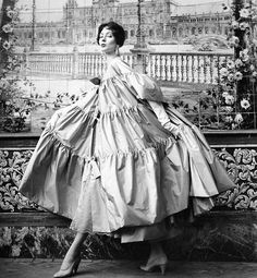 Suzy Parker wearing a taffeta evening coat by Manuel Pertegaz for Vogue UK, 1954. Photo by Henry Clarke.
