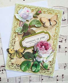 This handmade thinking of you card features two lovely large pink roses that are layered and three dimensional. This unique card also has a gold foil printed paper, pearl embellishments, and two lovely 3D butterflies. Thinking of You with gold foil detail is layered on the front while the inside is left blank so you can express your own heartfelt message. This card is perfect for any occasion and would make a great friendship card, thinking of you card, and as an I love you card. This card…