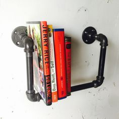 Install a solid spot for your book club's lineup with an industrial pipe book shelf.