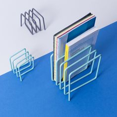Wire Magazine Rack. Store up to 8 magazines, files or vinyl records. An innovative design by Block using a length of wire looped into a cube