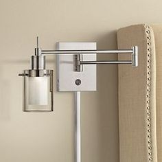 With a neutral brushed silver finish, this metal swivel LED wall lamp works perfectly in any contemporary setting. high x wide. Round backplate is 4 wide. Shade is wide x high. Style # at Lamps Plus. Plug In Wall Lamp, Wall Mounted Lamps, Led Wall Lamp, Modern Wall Sconces, Swing Arm Wall Lamps, Focus Light, Silver Walls, Bedside Lighting, New Wall