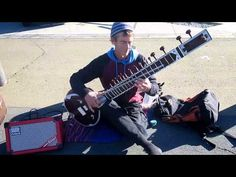 Greg Douch plays the Sitar from India on the Wellington waterfront. A beautiful Wellington day to catch Humans of Wellington at their creative best. It's a rare opportunity to catch a Sitar player for a free treat, so we dropped some $$ into the large case. Greg plays at NZ's Indian Community celebrations such as the Diwali Festival of Light and Ratha Yatra, which marks the journey of Lord Jagannatha across India.