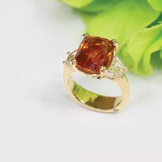 Cushion cut orange sapphire and diamond ring in 14 karat yellow gold. Orange Sapphire, Custom Jewelry, Sterling Silver Rings, Fashion Jewelry, Engagement Rings, Jewels, Diamond, Gold