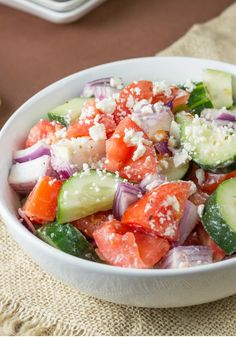 Tomato-Feta Village Salad – You'll need just five ingredients—including tomatoes, cucumbers, and feta cheese—to make this classic Greek salad recipe for any occasion. Feta Cheese Recipes, Bean Salad Recipes, Cooking Recipes, Healthy Recipes, Muffin Recipes, Family Recipes, Healthy Meals, Yummy Recipes, Diet Recipes
