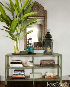 In the living room, Dalton pairs Michael S. Smith's Ships Table console for Jasper with an antique Syrian mirror.