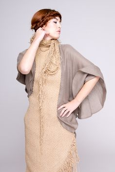 Irregular dress with frayed edges made from rustic jute and linen.